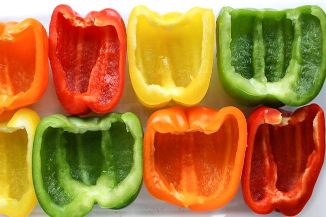 colorful bell pepper halves sitting open faced on a pan