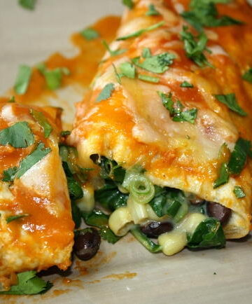 Black Bean Spinach Enchiladas on a plate with fork