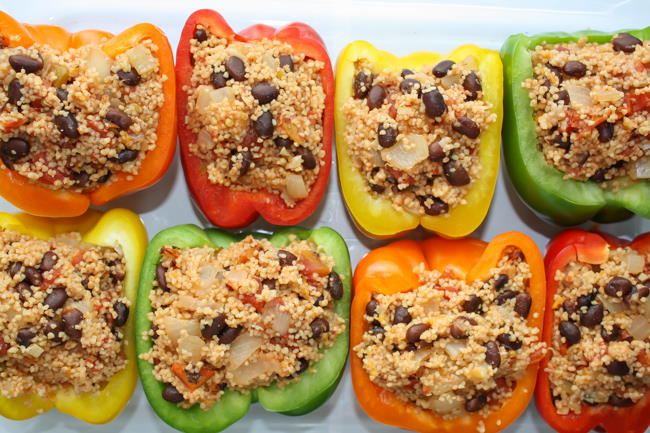 Pan of couscous stuffed bell peppers with black beans