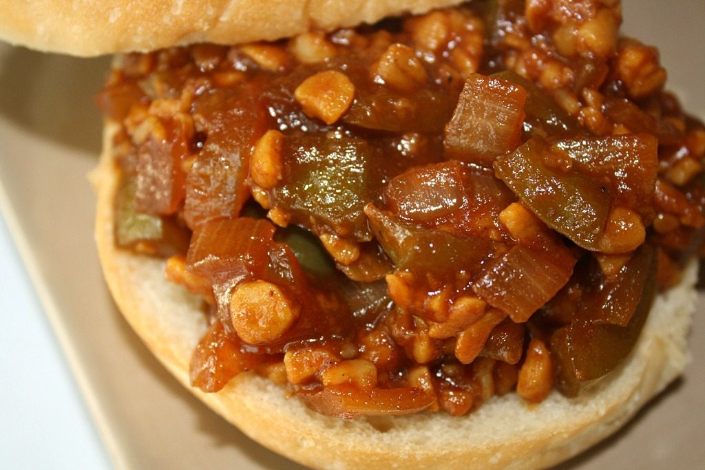 Vegan tempeh sloppy joe on an open-faced bun
