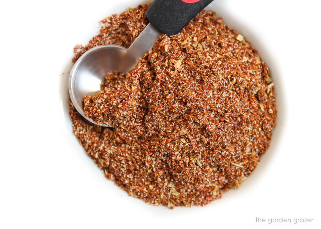 homemade taco seasoning in a bowl with teaspoon