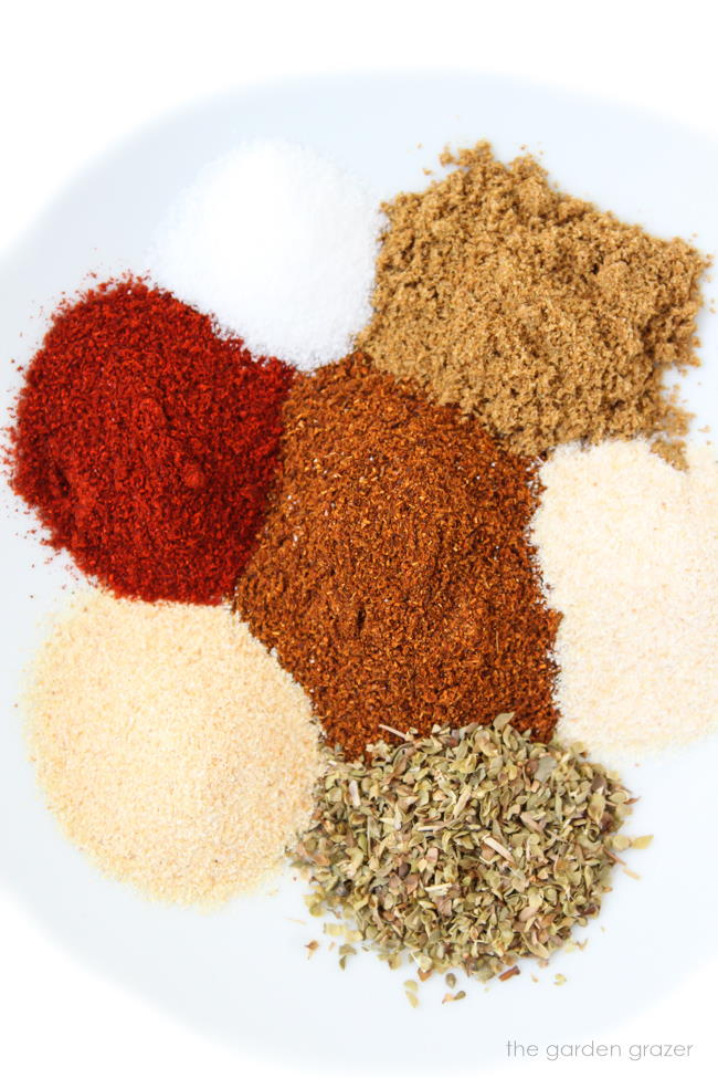spices on a plate for homemade taco seasoning