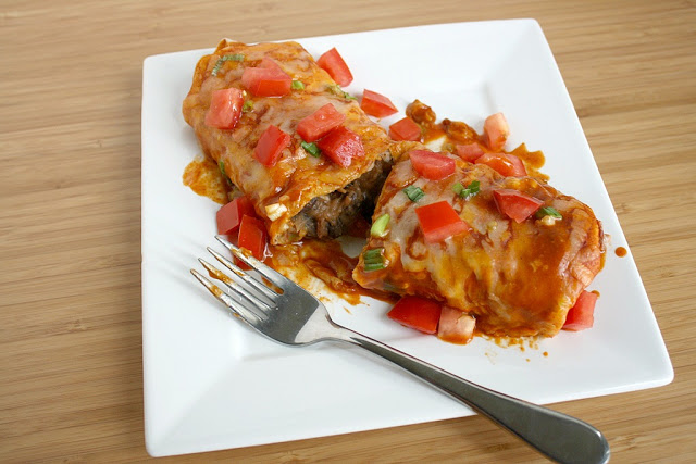 Vegan bean enchiladas on a plate with fork