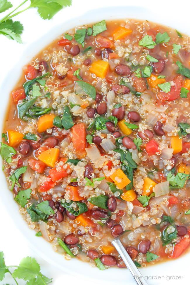 Bowl of vegan quinoa black bean soup with cilantro