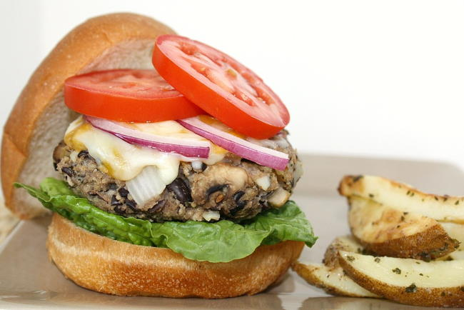 Side view of vegan black bean mushroom burger on a plate