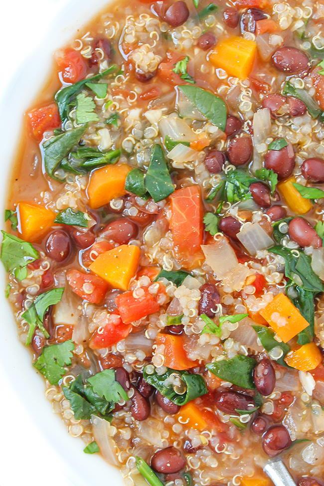 Vegan quinoa black bean soup in a white bowl