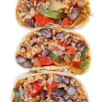 Vegan black bean quinoa burritos cut in half