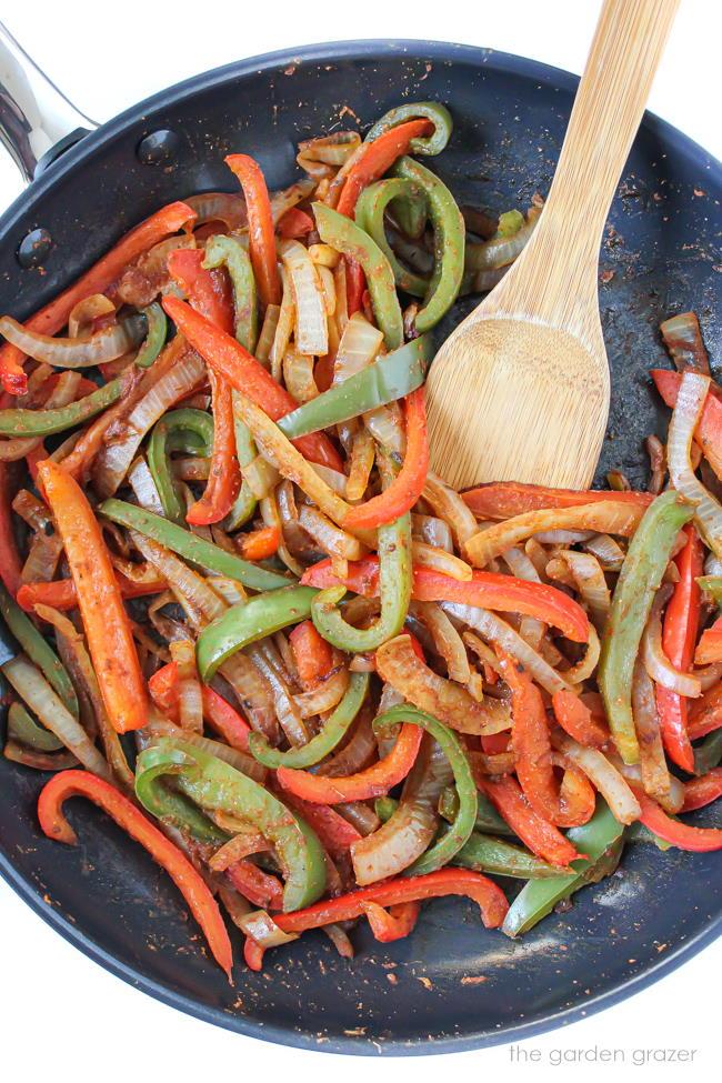 Fajita vegetables cooking in a pan