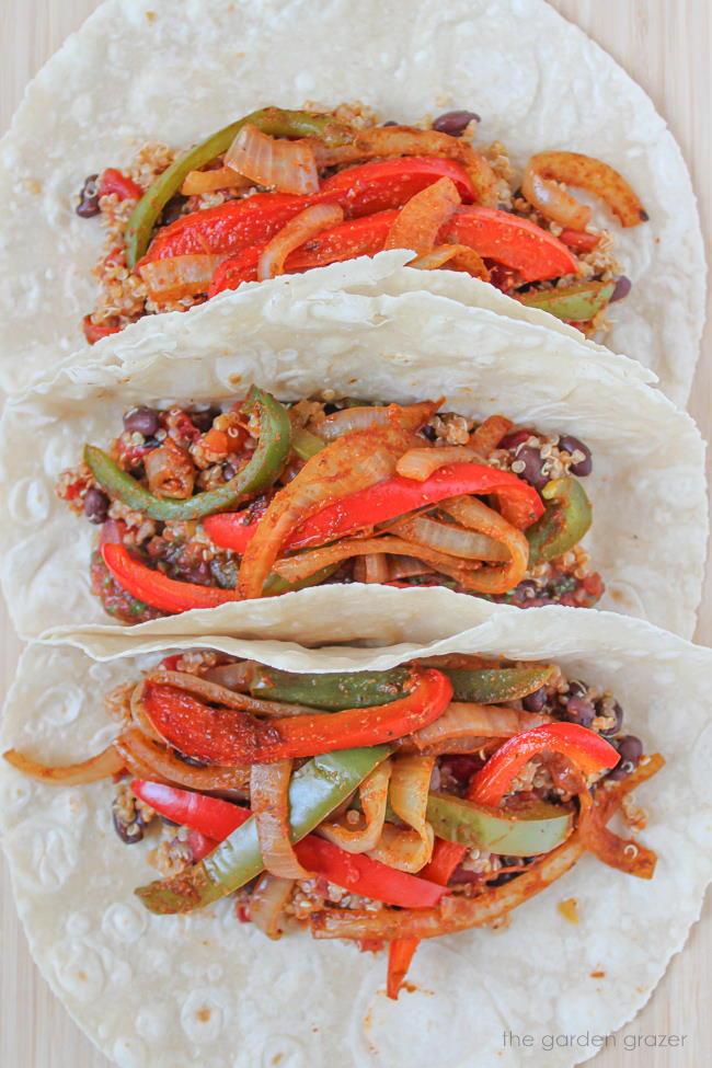 Three open-faced vegan quinoa burritos