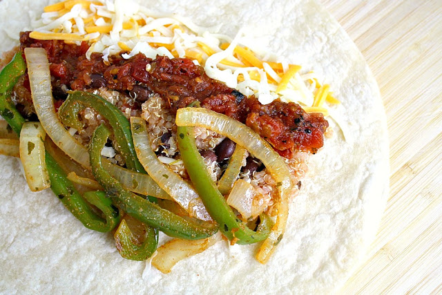 Quinoa fajita burritos on a cutting board