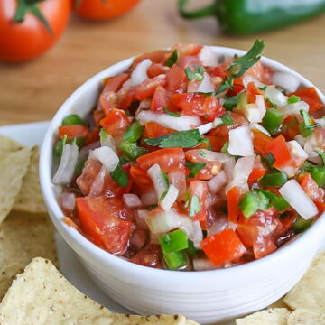 Bowl of fresh salsa fresca with chips on the side