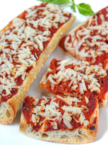 Vegan french bread pizza on a plate