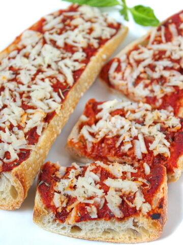 Vegan French bread pizza on a white plate