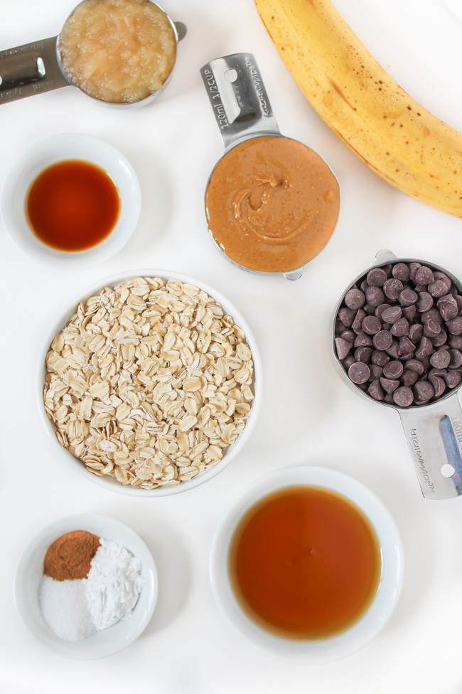 Ingredients on a table for vegan chocolate chip banana oatmeal cookies