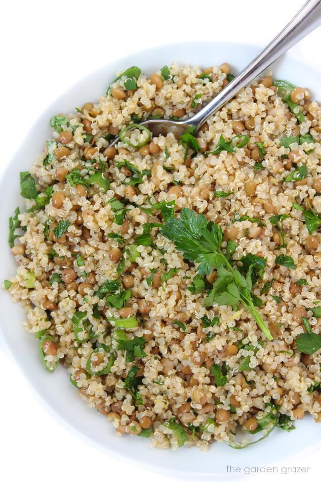 Bowl of vegan lentil quinoa salad with spoon