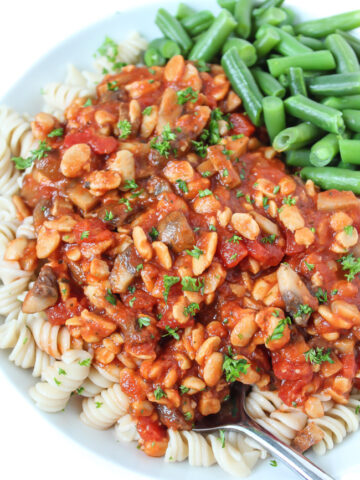 Plate of tempeh mushroom pasta with green beans