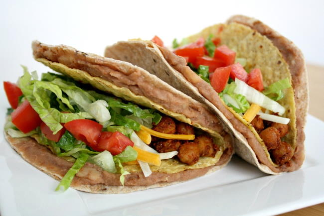 White plate with vegan chickpea tacos