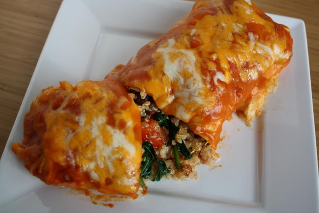 Vegetable quinoa enchilada with homemade sauce on a white plate