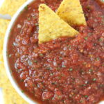 Blender salsa in a bowl with tortilla chips