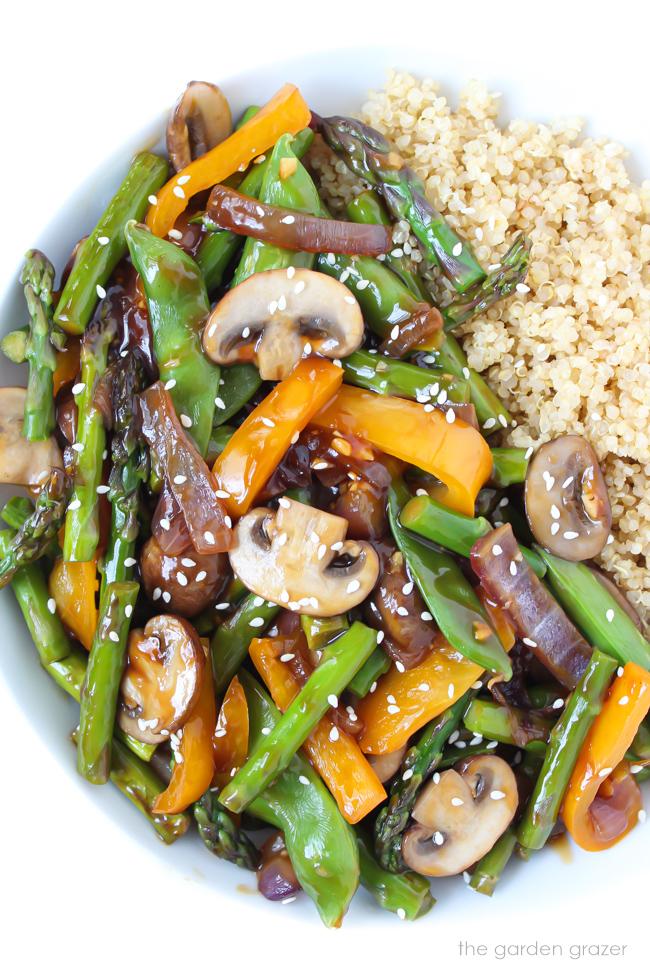 Bowl of quinoa vegetable stir fry with sesame seeds