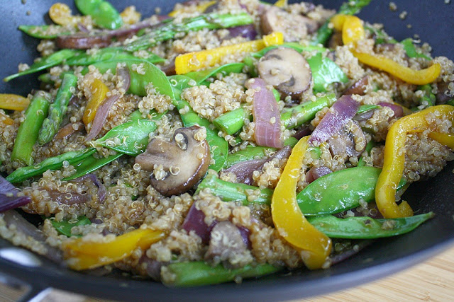 Stir fry with quinoa and veggies cooking in a pan