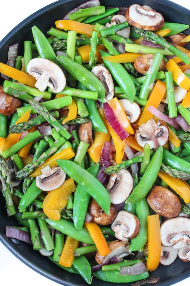 Stir frying vegetables in a large skillet