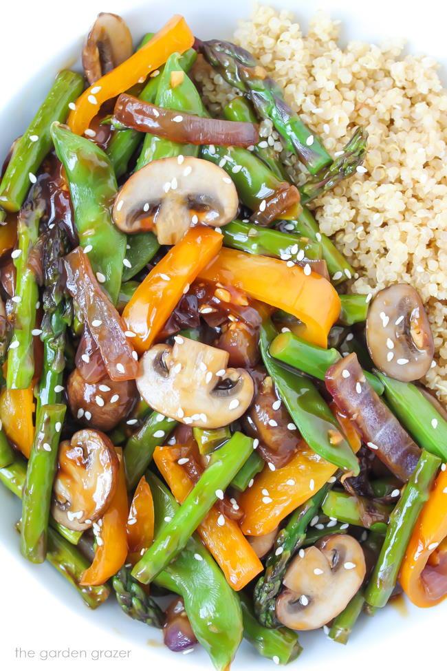 Stir-fried vegetables in a bowl with sesame seeds
