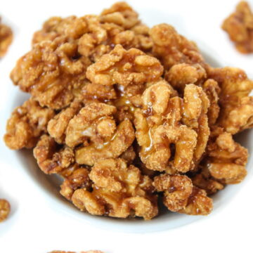 Bowl of maple candied walnuts with vanilla