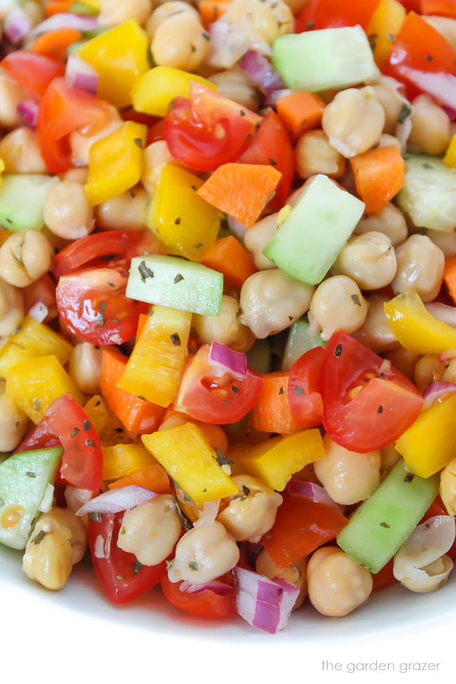 Close-up view of vegan chickpea vegetable salad in a bowl