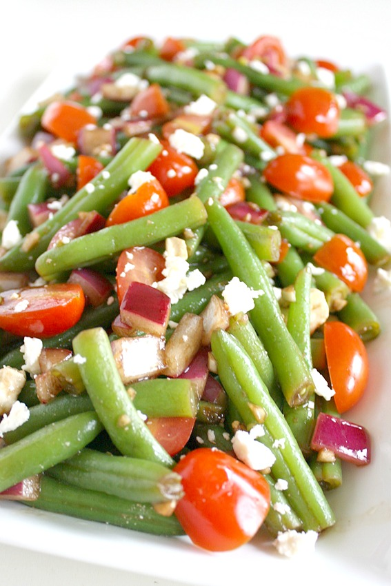 Plate of green bean salad with tomatoes and balsamic