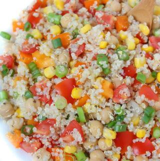 Bowl of quinoa vegetable salad with lemon basil dressing
