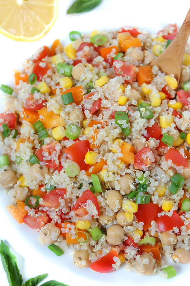 Bowl of quinoa vegetable salad with lemon basil dressing