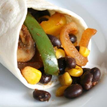 Black bean fajitas in a tortilla on a plate