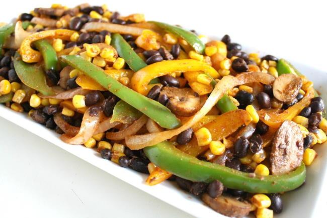 Plate of black bean fajitas with bell pepper, mushrooms and corn