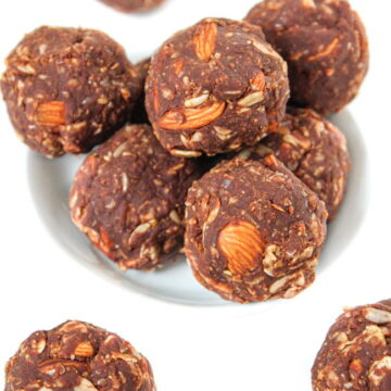 Small bowl of vegan chocolate peanut butter oat balls