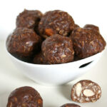Small bowl of vegan chocolate peanut butter oat balls
