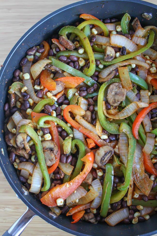 Corn and black bean fajitas in a skillet