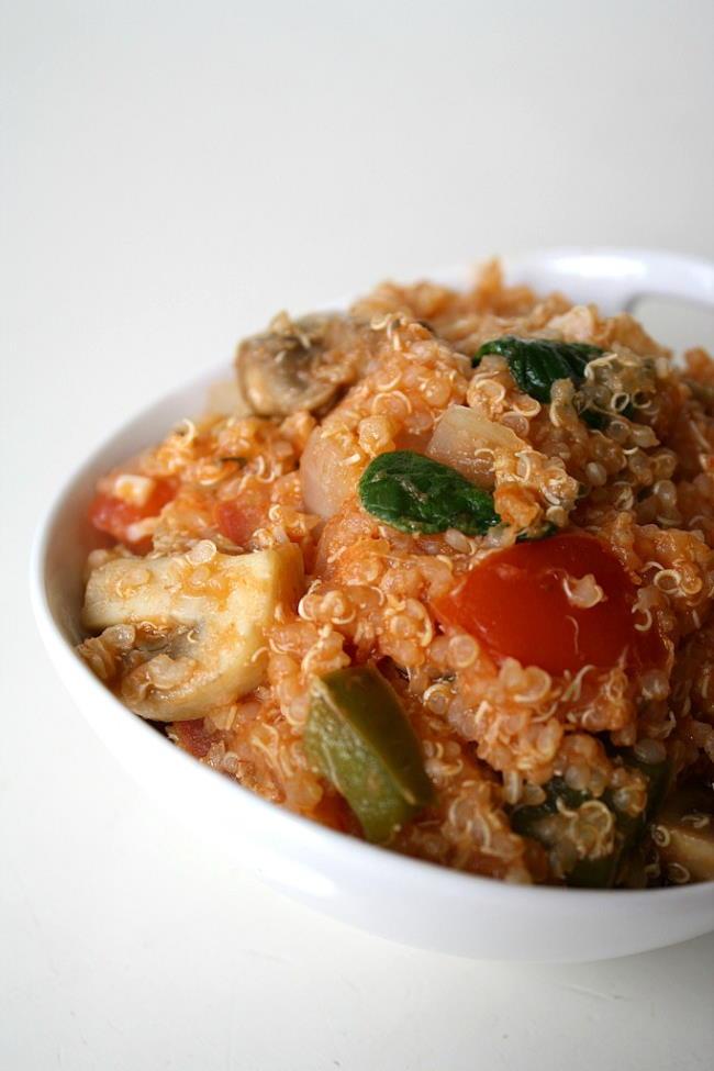 Vegan vegetable supreme pizza quinoa casserole in a small white bowl