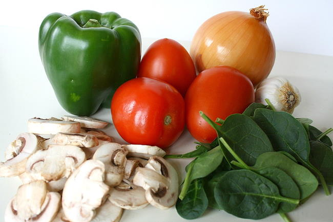 Raw vegetable ingredients for quinoa casserole on a table