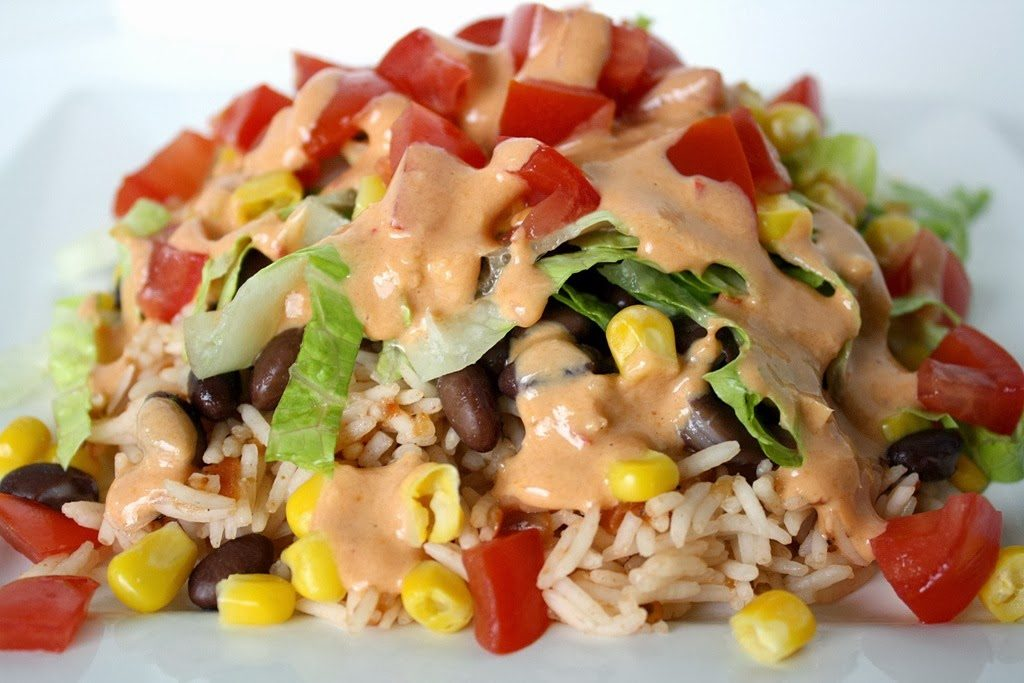 Black bean burrito bowl with creamy chipotle sauce on a plate