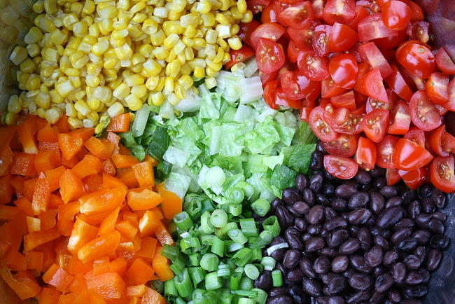 Ingredients in a bowl for southwestern chopped salad