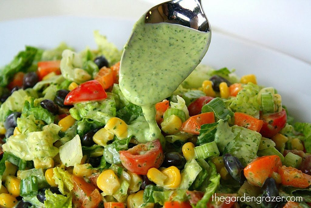Southwestern Chopped Salad being dressed with avocado dressing