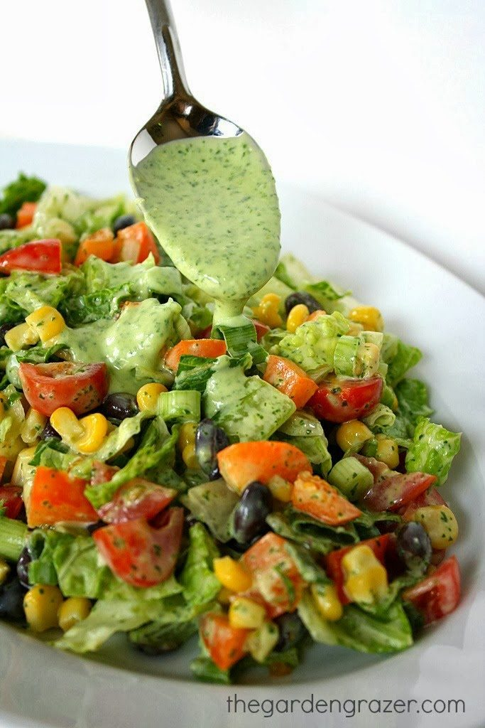 Southwestern Chopped Salad with avocado dressing on a spoon