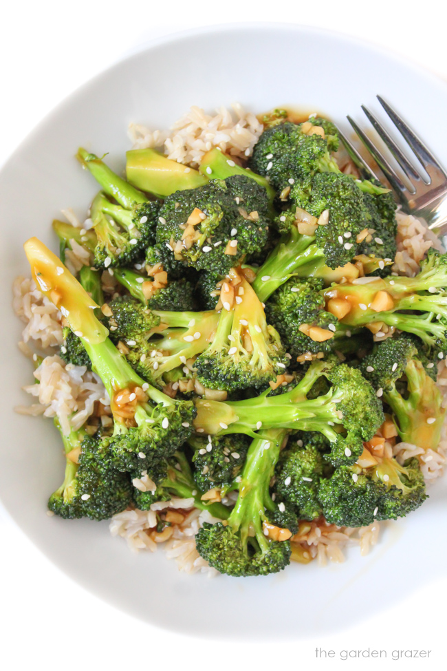 Bowl of broccoli with Asian Garlic Sauce sprinkled with sesame seeds