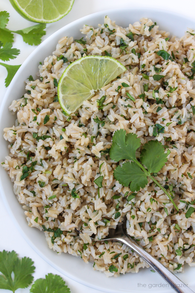 Cilantro lime brown rice in a bowl with spoon