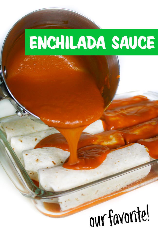 Enchilada sauce being poured from pan over the top of enchiladas