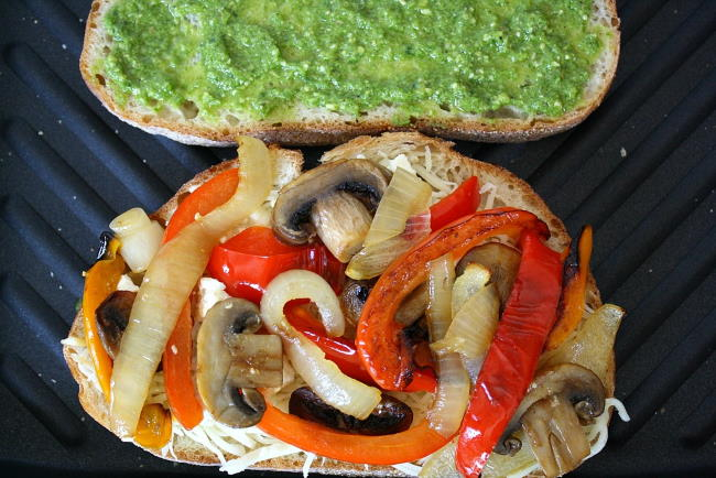 Vegan pesto panini cooking on a grill pan