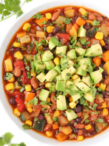 Bowl of summer chili with tomato and zucchini
