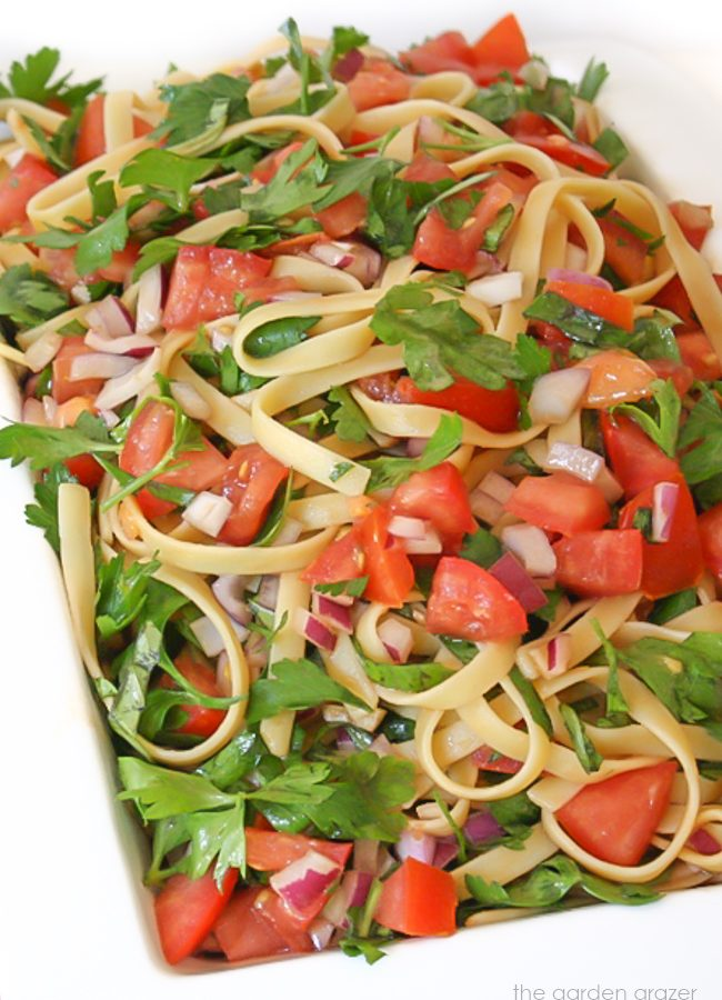 Fettuccine in a bowl with tomatoes and herbs