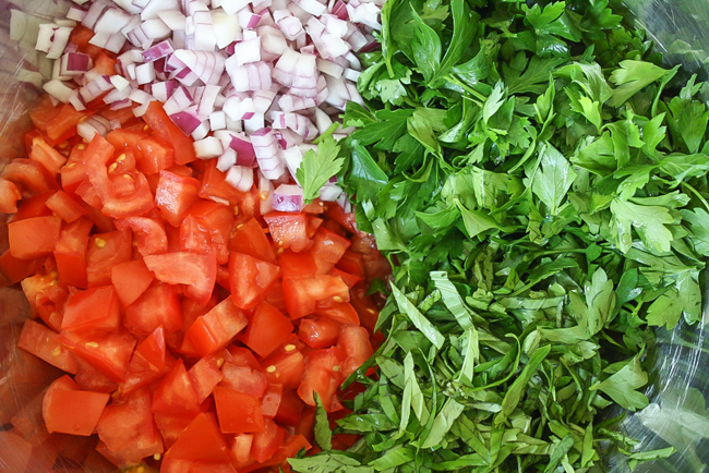 Chopped ingredients for tomato fettuccine in a bowl